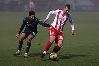 Luke Norris of Stevenage and Ben Cabango of Swansea City during Stevenage vs Swansea City, Emirates FA Cup Football at the Lamex Stadium on 9th January 2021