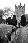 Village life 1975 UK St Peters Church of Saint Peter after Sunday morning service 1970s Britain UK. The Cotswolds. Lower and Upper Slaughter are twin villages on the River Eye and are know as The Slaughters.
