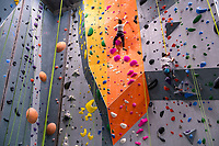 Students make their way up a wall as Alaska Rock Gym operations manager and UAA recreation course instructor Eric Wickenheiser teaches Beginning Indoor Sport Climbing (PER A148) at the Alaska Rock Gym in Anchorage.