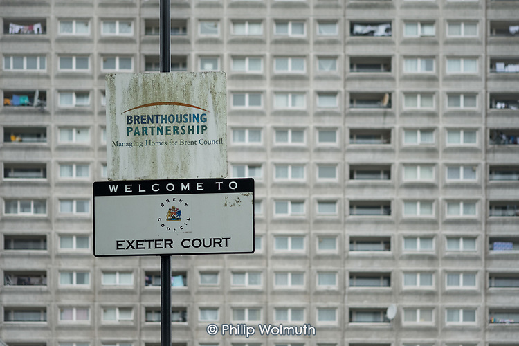 Brent Housing Partnership and Exeter Court sign in front of the scheduled-for-demolition 18 storey Herefordshire House, South Kilburn Estate, London Borough of Brent.