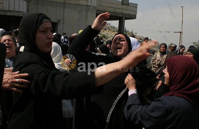 Palestinian women react during the funeral of Fayeez Ata, who was killed Wednesday by Israeli soldiers, in the West Bank village of Dir Mishaal, north of Ramallah, Thursday, March 12, 2009.APAIMAGES PHOTO /Issam rimawi