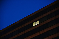 Empty office buildings are seen at night in the Foggy Bottom area of Washington, D.C., on Wed., Nov. 4, 2020.