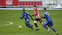 Sergi Canos of Brentford takes on Nampalys Mendy of Leicester City during Brentford vs Leicester City, Emirates FA Cup Football at the Brentford Community Stadium on 24th January 2021