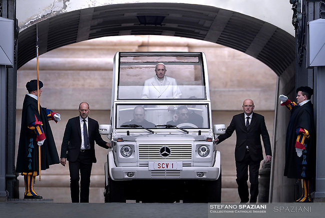 Pope Francis, escorted by security guards, arrives in St.Peter's Square for the   special Jubilee Audience,<br /> On the left of the Pope the Commander Swiss guards Christoph Graf to right  personal bodyguard, Domenico Giani  is the Inspector General of the Corpo della Gendarmeria, the police and security force of  Vatican City<br /> at the Vatican on January 30, 2016.
