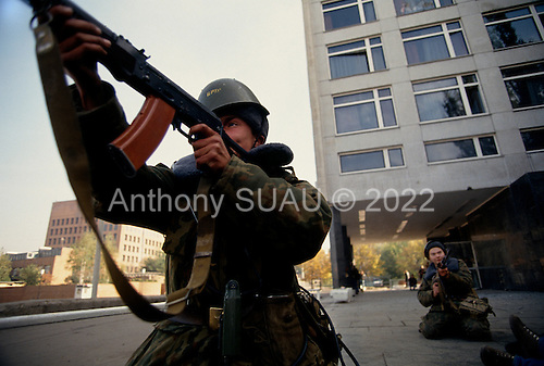 Moscow, Russia.October 4, 1993..Russian troops take up positions at the Mir Hotel on Novy Arbat Street, across the street from the US Embassy, surrounding the Parliament building in hopes of removing hundreds of well armed anti-Yeltsin demonstrators held up inside. ..Russian soldiers fire at will at anti-Yeltsin demonstrators.