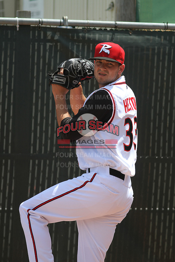 Richmond Flying Squirrels pitcher Chris Heston #33 throwing in the bullpen before a game against the Trenton Thunder at The Diamond on May 27, 2012 in Richmond, Virginia. Richmond defeated Trenton by the score of 5-2. (Robert Gurganus/Four Seam Images)