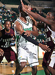 North Texas Mean Green forward George Odufuwa (4) passes the ball while Texas State Bobcats forward J.B. Conley (20) is trying to block him in the game between the Texas State Bobcats and the University of North Texas Mean Green at the North Texas Coliseum,the Super Pit, in Denton, Texas. UNT defeated Texas State 85 to 62