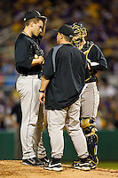 Wake Forest Demon Deacons coach Dennis Healy #12 has a chat with Austin Stadler #9 and Mike Lubanski #10 during first inning action against the LSU Tigers at Alex Box Stadium on February 18, 2011 in Baton Rouge, Louisiana.  The Tigers defeated the Demon Deacons 15-4.  Photo by Brian Westerholt / Four Seam Images