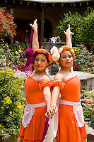 Colorful dancers age 13 and 14 in beautiful courtyard in tourist village of Antigua Guatemal