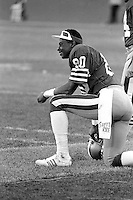 SAN FRANCISCO, CA - Jerry Rice of the San Francisco 49ers kneels on the sidelines during a game against the St. Louis Cardinals at Candlestick Park in San Francisco, California in 1986. Photo by Brad Mangin
