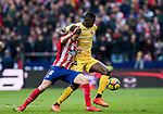 Saul Niguez Esclapez (L) of Atletico de Madrid fights for the ball with Michael Olunga Ogada of Girona FC during the La Liga 2017-18 match between Atletico de Madrid and Girona FC at Wanda Metropolitano on 20 January 2018 in Madrid, Spain. Photo by Diego Gonzalez / Power Sport Images