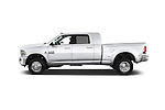 Car driver side profile view of a 2015 Ram 3500 Laramie Mega Cab 4 Door Van