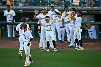 Bradenton Marauders Abrahan Gutierrez (27) is greeted at the dugout by Francisco Acuna (3), Adrian Florencio (45), Maikol Escotto (35), and Daniel Rivero (23) after hitting a home run during Game Two of the Low-A Southeast Championship Series against the Tampa Tarpons on September 22, 2021 at LECOM Park in Bradenton, Florida.  (Mike Janes/Four Seam Images)