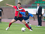 St Johnstone v FC Minsk...01.08.13 Europa League Qualifier at Neman Stadium, Grodno, Belarus...<br /> Nigel Hasselbaink is fouled by Aliaksandr Sviarchynski<br /> Picture by Graeme Hart.<br /> Copyright Perthshire Picture Agency<br /> Tel: 01738 623350  Mobile: 07990 594431