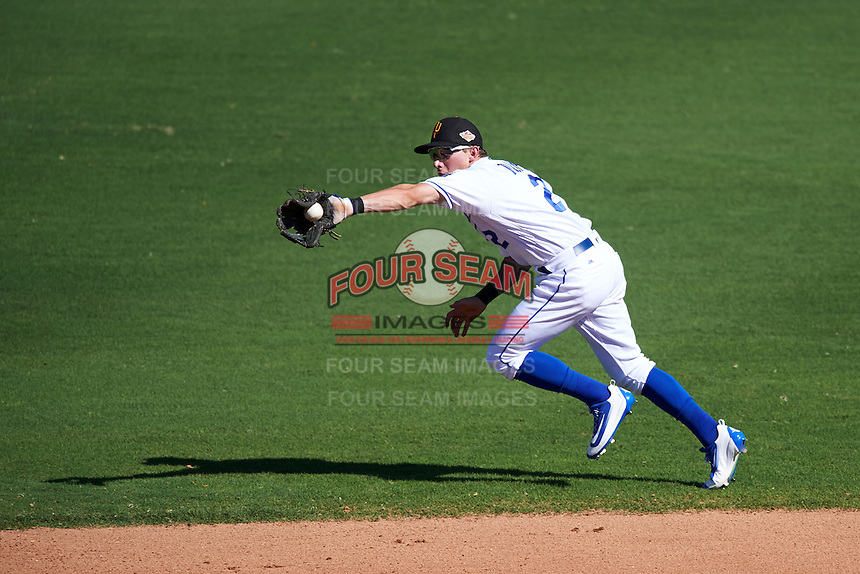 Surprise Saguaros Corey Toups (2), of the Kansas City Royals organization, fields a ball up the middle during a game against the Salt River Rafters on October 17, 2016 at Surprise Stadium in Surprise, Arizona.  Surprise defeated Salt River 3-1.  (Mike Janes/Four Seam Images)