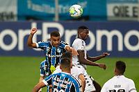 14th October 2020; Arena de Gremio, Porto Alegre, Brazil; Brazilian Serie A, Gremio versus Botafogo; Alisson of Gremio and Kanu of Botafogo challenge for a header
