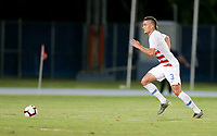 GEORGETOWN, GRAND CAYMAN, CAYMAN ISLANDS - NOVEMBER 19: Aaron Long #23 of the United States moves with the ball during a game between Cuba and USMNT at Truman Bodden Sports Complex on November 19, 2019 in Georgetown, Grand Cayman.