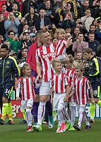 May 13th 2017, Bet365 Stadium, Stoke, Staffordshire, England; EPL Premier league Stoke City versus Arsenal;Ryan Shawcross of Stoke City and children lead the teams out at the start of the game