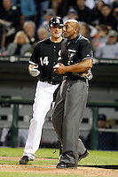 August 7, 2009:  First Baseman Paul Konerko (14) of the Chicago White Sox argues that he was hit by a pitch with home plate umpire CB Bucknor during a game vs. the Cleveland Indians at U.S. Cellular Field in Chicago, IL.  The Indians defeated the White Sox 6-2.  Photo By Mike Janes/Four Seam Images