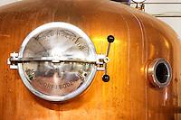 A distillation machine still in stainless steel and copper with narrow column. Marked Arnold Holstein Markdorg, Bodensee.. Hercegovina Produkt winery, Citluk, near Mostar. Federation Bosne i Hercegovine. Bosnia Herzegovina, Europe.