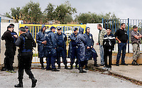 Pictured: Police attend Profitis Volvis primary school, Salonica, Greece. Monday 10 October 2016<br /> Re: Locals protesting against children of refugees attending school, have locked the gates of the primary school in Profitis Volvis on the outskirts of Thessaloniki in northern Greece. Police were present and the children were escorted through another gate.