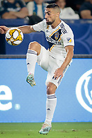 CARSON, CA - SEPTEMBER 15: Sebastian Lletget #17 of the Los Angeles Galaxy moves with the ball during a game between Sporting Kansas City and Los Angeles Galaxy at Dignity Health Sports Complex on September 15, 2019 in Carson, California.