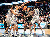 WASHINGTON, DC - FEBRUARY 19: Jamorko Pickett #1, Jagan Mosely #4 and Timothy Ighoefe #5 of Georgetown surround Nate Watson #0 of Providence during a game between Providence and Georgetown at Capital One Arena on February 19, 2020 in Washington, DC.