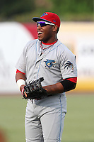 Clearwater Threshers Jonathan Singleton #3 warms up before a game against the Tampa Yankees at Steinbrenner Field on June 22, 2011 in Tampa, Florida.  The game was suspended due to rain in the 10th inning with a score of 2-2.  (Mike Janes/Four Seam Images)