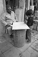 In Cairo, Egypt, children are learning early to carve marble. Child labor as seen around the world between 1979 and 1980 – Photographer Jean Pierre Laffont, touched by the suffering of child workers, chronicled their plight in 12 countries over the course of one year.  Laffont was awarded The World Press Award and Madeline Ross Award among many others for his work.