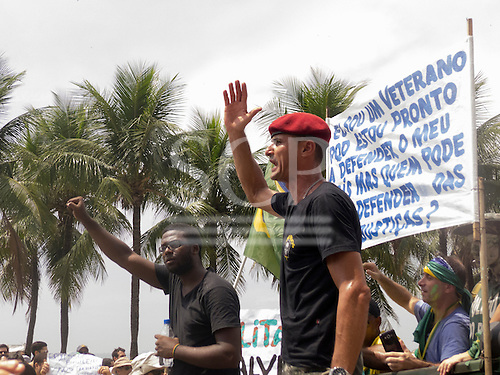 Military veteran chants in protest with an Afro-Brazilian beside him. Rio de Janeiro, Brazil. Demonstration against President Dilma Rousseff.