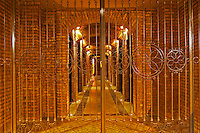 The wrought iron gate that leads to the brick bottle aging cellar. Bodega Familia Schroeder Winery, also called Saurus, Neuquen, Patagonia, Argentina, South America