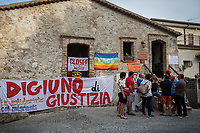 """Hunger Strike for Justice.<br /> <br /> Riace (Calabria, Italy), 04/08/2018. Visiting Riace for the third day of the """"Riace in Festival"""", 'Festival delle Migrazioni e delle Culture Locali' (Festival of Migration and Local Cultures). Attending the festival, amongst others, were the Mayor of Napoli Luigi De Magistris and the Mayor of Barcelona Ada Colau, debating with the Mayor of Riace, Domenico 'Mimmo' Lucano, about the so called """"migration crisis"""", as well as the now famous """"Modello Riace"""" (The Riace Model: how to welcome and work with Migrants to invest in building a future together). Other speakers included: Tiziana Barillà, Journalist at """"il Salto"""" (1) and Author of the book """"Mimi Capatosta. Mimmo Lucano e il modello Riace"""" (2),  Magistrates Riccardo De Vito and Emilio Sirianni (in turn President and Member of Magistratura Democratica). Chair of the event was Ilaria Bonaccorsi, Historian & Journalist at """"il Salto"""".<br /> From the Festival website: """"RIACE in FESTIVAL, is an event born in the wake of the policy of reception and resettlement of refugees and asylum seekers that the city administration of the """"Riace Bronzes'"""" town has been implementing for years. [...] The festival aims to be a concrete initiative that, through the universal language of cinema and the arts, promotes the exchange and mutual knowledge to counteract forms of closure and racism, drawing attention to the innovative path that the municipal administration of Riace has started by combining the reception of migrants with the revival of its territory and giving the image of an unpublished Calabria, different from that of the black chronicle>>.<br /> Riace is a small village in the province of Reggio Calabria. It's famous because on the 16 August 1972 Stefano Mariottini, a chemist from Rome, found two full-size Greek bronzes... (Riace Bronzes: https://bit.ly/2oBoFNY)<br /> (For the full caption read the ARTICLE at the the beginning of this story)"""