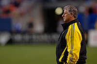 Columbus Crew head coach Sigi Schmid looks on as his team drops their second consecutive game of the season at Denver's Invesco Field at Mile High Stadium, April 8, 2006.