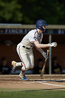 Britt Fuller (32) (Duke) of the High Point-Thomasville HiToms follows through on his swing against the Statesville Owls at Finch Field on July 19, 2020 in Thomasville, NC. The HiToms defeated the Owls 21-0. (Brian Westerholt/Four Seam Images)