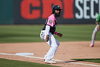 Brian Goodwin (36) of the Charlotte Knights takes his lead off of third base against the Gwinnett Stripers at Truist Field on May 9, 2021 in Charlotte, North Carolina. (Brian Westerholt/Four Seam Images)