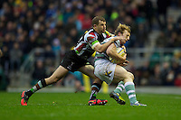 Patrick Phibbs of London Irish (right) is tackled by Nick Evans of Harlequins during the Aviva Premiership match between Harlequins and London Irish at Twickenham on Saturday 29th December 2012 (Photo by Rob Munro).