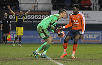 Matt Macey of Luton Town collects the ball as Kane Hemmings of Oxford United (L) appeals to referee Nigel Miller during the The Checkatrade Trophy Semi Final match between Luton Town and Oxford United at Kenilworth Road, Luton, England on 1 March 2017. Photo by Stewart  Wright  / PRiME Media Images.