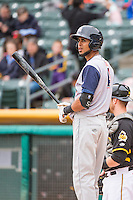 Yadiel Rivera (4) of the Colorado Springs Sky Sox at bat against the Salt Lake Bees in Pacific Coast League action at Smith's Ballpark on May 22, 2015 in Salt Lake City, Utah.  (Stephen Smith/Four Seam Images)