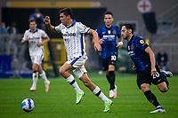 Milan, Italy - september 25 2021 - Serie A match F.C. Internazionale - Atalanta BC San Siro stadium - pessina matteo atalanta bc and calhanoglu hakan f.c. internazionale