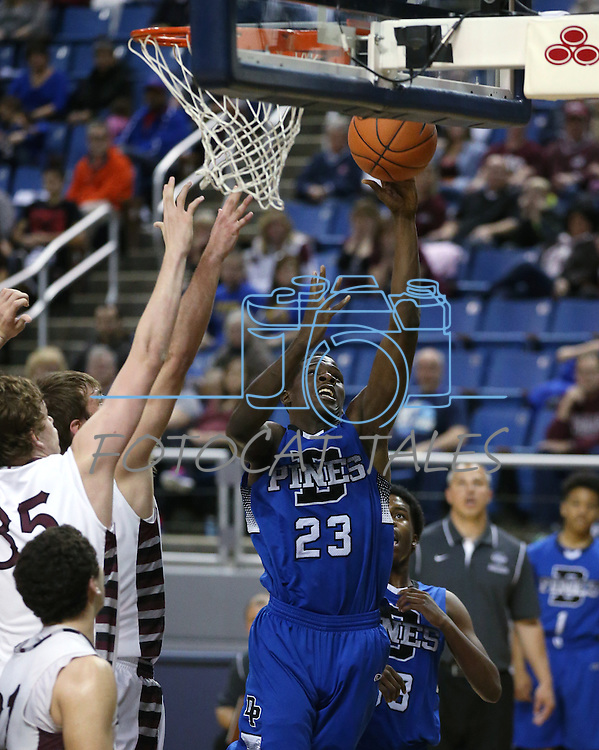 Desert Pines' Dominic Deloney shoots through a crowd of Elko defenders during a Division IA semi-final game in the NIAA state tournament at Lawlor Events Center, in Reno, Nev., on Friday, Feb. 28, 2014. Elko won 63-47. (Cathleen Allison/Las Vegas Review-Journal)