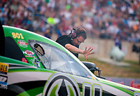 Jul 20, 2018; Morrison, CO, USA; Crew member for NHRA funny car driver Jonnie Lindberg during qualifying for the Mile High Nationals at Bandimere Speedway. Mandatory Credit: Mark J. Rebilas-USA TODAY Sports