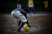 Countryside Brazil soccer - player is carefully positioning the ball for a penalty shoot-out. Black boys with remarkable talent for soccer usually have the nickname of Pele in Brazil. Rural area of Maranhao State, Northeastern Brazil.