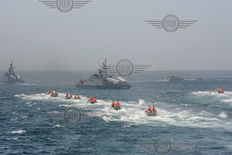 Military ships and fast boats from Iran's elite Revolutionary Guards during manoeuvres off Larak Island in the Persian (Arabian) Gulf.