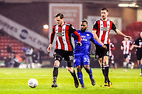 Sheffield United's defender Richard Stearman (19)  beats Cardiff City's midfielder Junior Hoilett (33)  during the Sky Bet Championship match between Sheff United and Cardiff City at Bramall Lane, Sheffield, England on 2 April 2018. Photo by Stephen Buckley / PRiME Media Images.