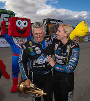 Oct 30, 2016; Las Vegas, NV, USA; NHRA funny car driver John Force (left) is congratulated by daughter Courtney Force as he celebrates after winning the Toyota Nationals at The Strip at Las Vegas Motor Speedway. Mandatory Credit: Mark J. Rebilas-USA TODAY Sports