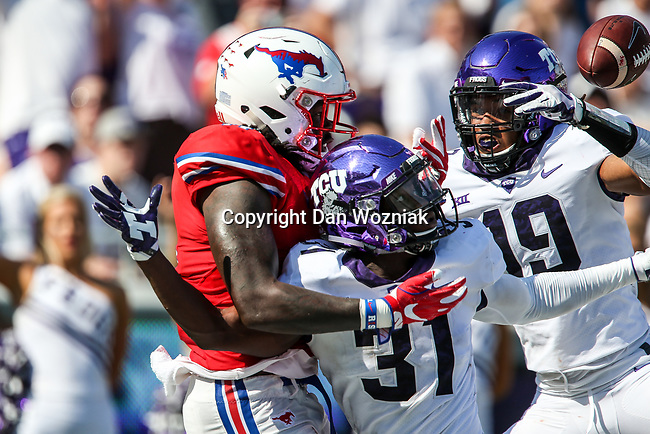 Southern Methodist Mustangs tight end Raymond Epps (11), TCU Horned Frogs safety Ridwan Issahaku (31) and TCU Horned Frogs wide receiver Omar Manning (19) in action during the game between the SMU Mustangs and the TCU Horned Frogs at the Amon G. Carter Stadium in Fort Worth, Texas.
