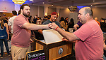 WATERBURY, CT 072231JS13 Dan Chieffo of Waterbury, right, get a sample of beer handed to him by Connor Norton, assistant brewer at 5 Churches Brewing in New Britain during the third annual Summer Beer Fest held Friday at the Courtyard Marriott in Waterbury. <br /> Jim Shannon Republican American
