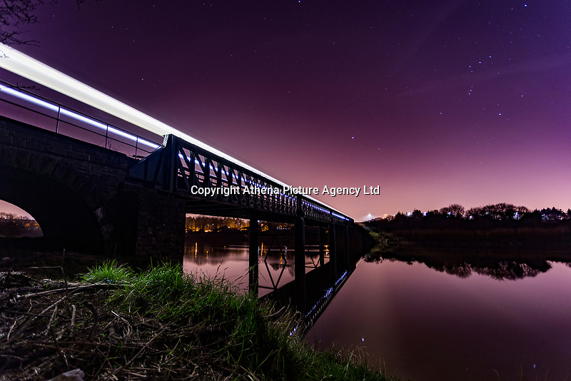 A high speed train travels on a bridge over a river in Caerleon Cycle Path, Newport, Wales, UK.<br /> Re: Below zero temperatures have hit most parts of the UK this month. This month will also have no full moon, a rare phenomenon which only happens during the month February and is known as Black Moon with January and March experiencing Blue Moons.