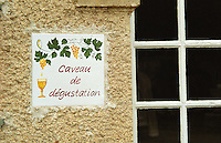A sign outside the tasting room saying caveau de degustation.  Chateau Mourgues du Gres Grès, Costieres de Nimes, Bouches du Rhone, Provence, France, Europe