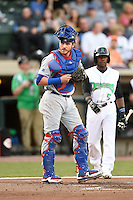 South Bend Cubs catcher Tyler Alamo (22) looks to the dugout as Shed Long (5) walks to the plate during a game against the Dayton Dragons on May 11, 2016 at Fifth Third Field in Dayton, Ohio.  South Bend defeated Dayton 2-0.  (Mike Janes/Four Seam Images)